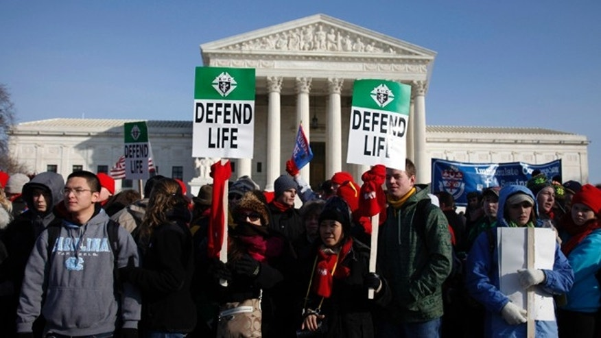 FILE: Jan. 2011: Pro-life protesters outside the Supreme Court during their annual March for Life in Washington, D.C.