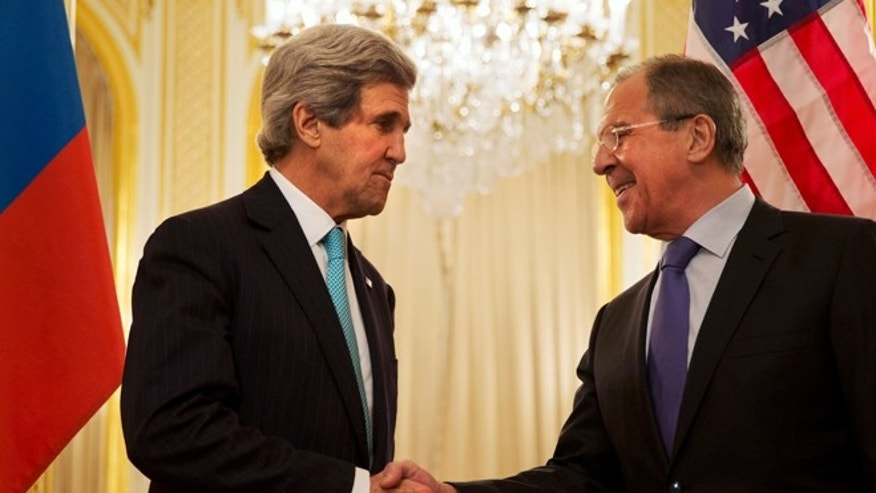 March 30, 2014: Secretary of State John Kerry, left, with Russian Foreign Minister Sergey Lavrov, in Paris.