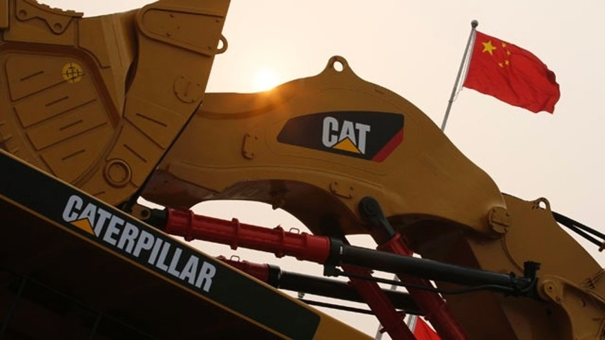 A Caterpillar excavator is displayed at the China Coal and Mining Expo 2013 in Beijing.