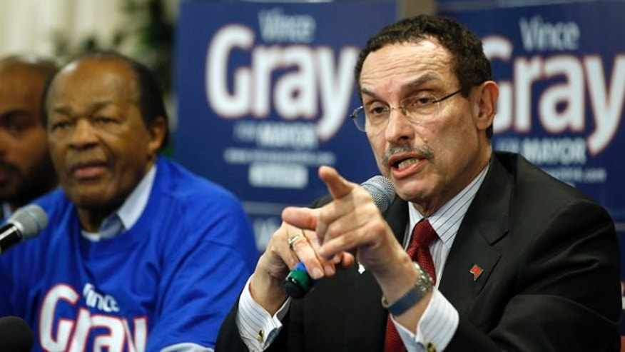March 19, 2014: D.C. Mayor Vincent Gray answers a question during a media availability with former mayor and DC City Council member Marion Barry, left, in Washington.