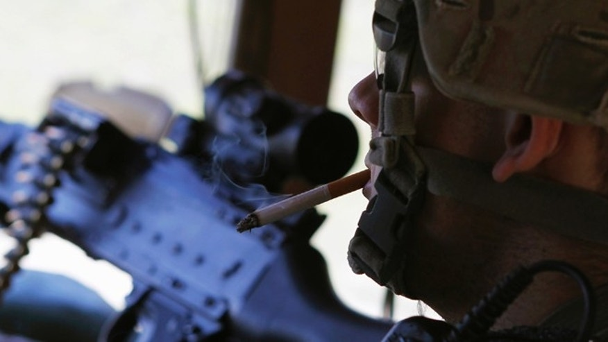 Sep. 26, 2011 U.S. soldier smokes a cigarette while manning his post in a bunker  in eastern Afghanistan.