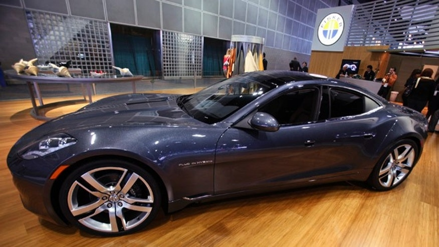 FILE: Nov. 18, 2010: In this file photo, Fisker Automotive's Fisker Karma, a sports luxury plug-in hybrid car, sits on display at the 2010 Los Angeles Auto Show in Los Angeles.