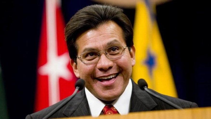 US Attorney General Alberto Gonzales speaks during a farewell ceremony in his honor.