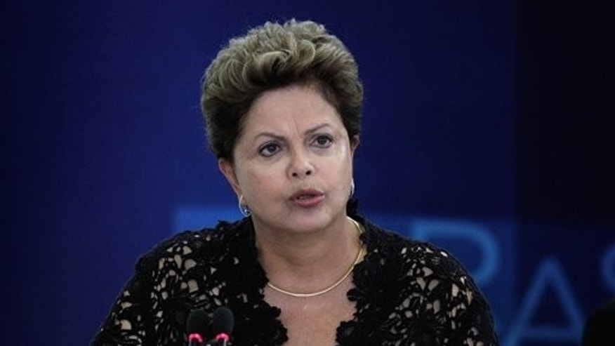 Brazil's President Dilma Rousseff speaks during a ceremony to present six new ministers to her cabinet, at the Planalto Presidential Palace, in Brasilia, Brazil, Monday, March 17, 2014.  President Rousseff announced changes in her Cabinet with an eye on the October elections in which some of her former ministers will run for Congress and regional government posts. (AP Photo/Eraldo Peres)