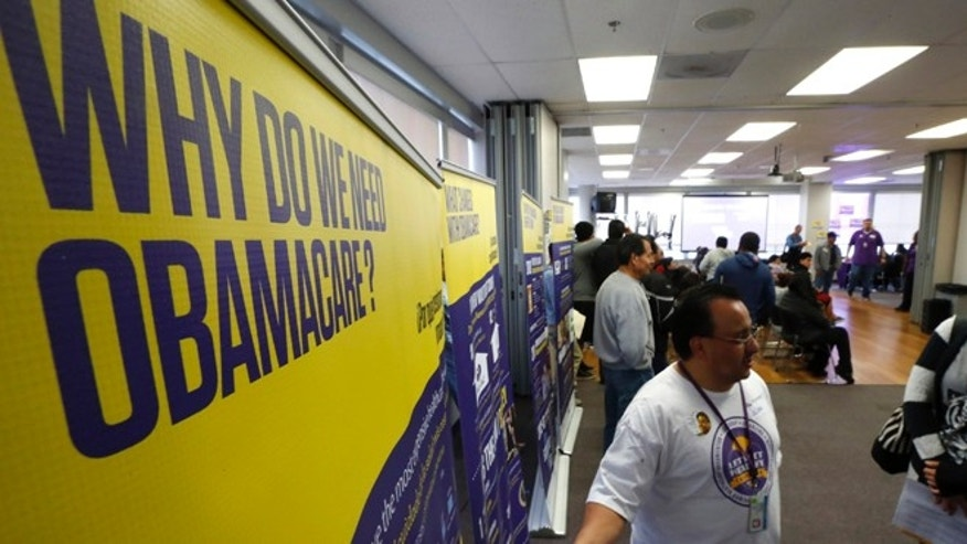 FILE: March 31, 2014: An ObamaCare enrollment event in Commerce, Calif.