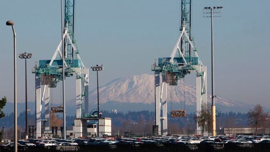 Shown in this Dec. 12, 2011 file photo are Port of Portland cranes, with Mount St. Helens in the background.