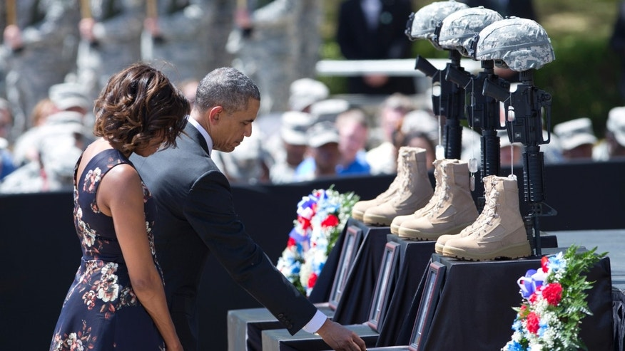 President Obama pays his respect during a memorial ceremony, Wednesday, April 9, 2014, at Fort Hood Texas.