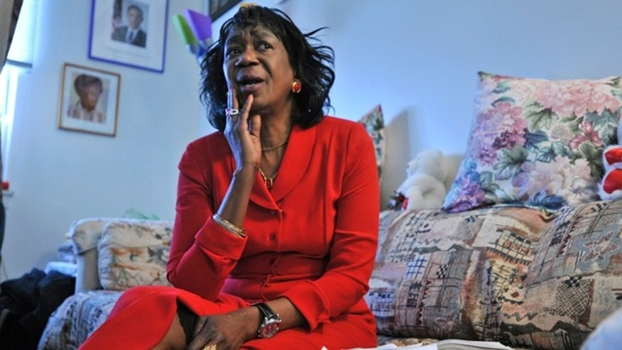 November 24, 2009:  President Barack Obama's aunt Zeituni Onyango speaks to The Associated Press during an interview in her home in Boston.  Onyango, whose status as an illegal immigrant was revealed days before Obama was elected in 2008, died Tuesday, according to Cleveland attorney Margaret Wong, who represented Onyango in her immigration case. She was 61.  (AP Photo/Josh Reynolds, File)