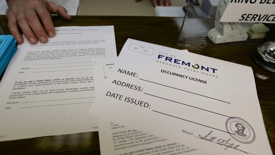 Application forms and an occupancy license certificate are seen at the police station in Fremont, Neb., Wednesday, April 9, 2014, where these licenses will be issued beginning Thursday as part of the city's ordinance aimed at combating illegal immigration. (AP Photo/Nati Harnik)