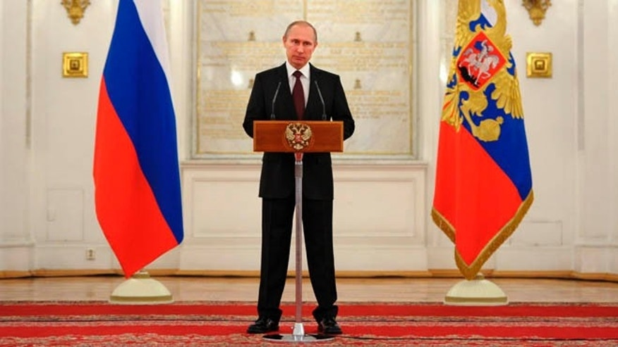 March 28, 2014: Russian President Vladimir Putin speaks in the Kremlin in Moscow.