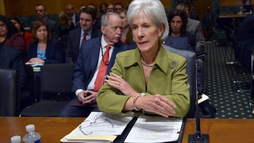 Health and Human Services Secretary Kathleen Sebelius prepares to testify on Capitol Hill, Thursday, April 10, 2014.