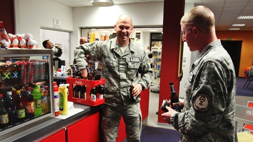 FILE: 2011: U.S. Air Force airman carries beers that he purchased, in Frankfurt, Germany.