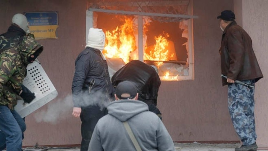 April 14, 2014: Pro-Russian men attack a police station in the eastern Ukrainian town of Horlivka.