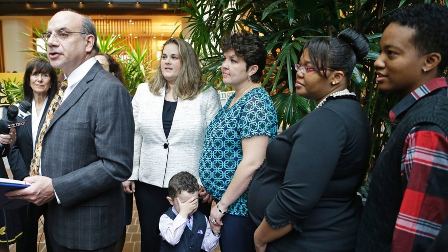 April 4, 2014: Attorney Al Gerhardstein, left, stands with several same-sex couples at a news conference.