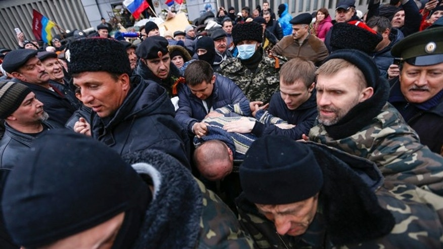 April 13, 2014: Pro-Russian protesters escort a man detained in eastern Ukraine.