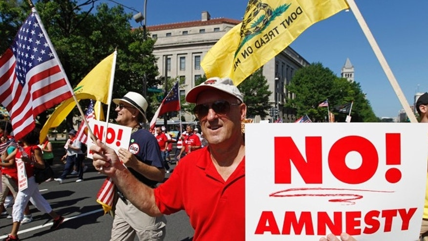 FILE: July 15, 2013: Demonstrators march against amnesty for illegal immigrants at a rally in Washington, D.C.