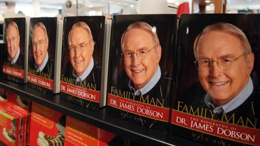 Copies of a biography of Dr. James Dobson, founder of Focus on the Family, are seen in the bookstore at the Focus headquarters in Colorado Springs, Colo.