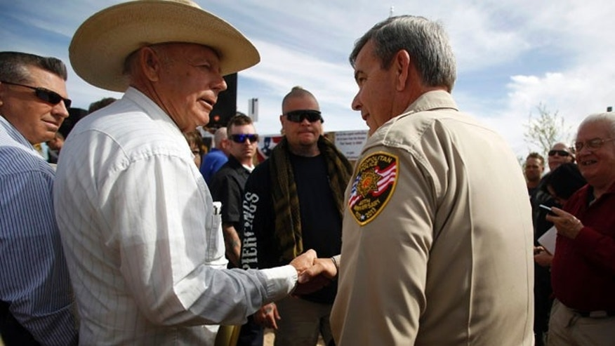 April 12, 2-014: Rancher Cliven Bundy (2nd L) greets Clark County Sheriff Douglas Gillespie in Bunkerville, Nevada.