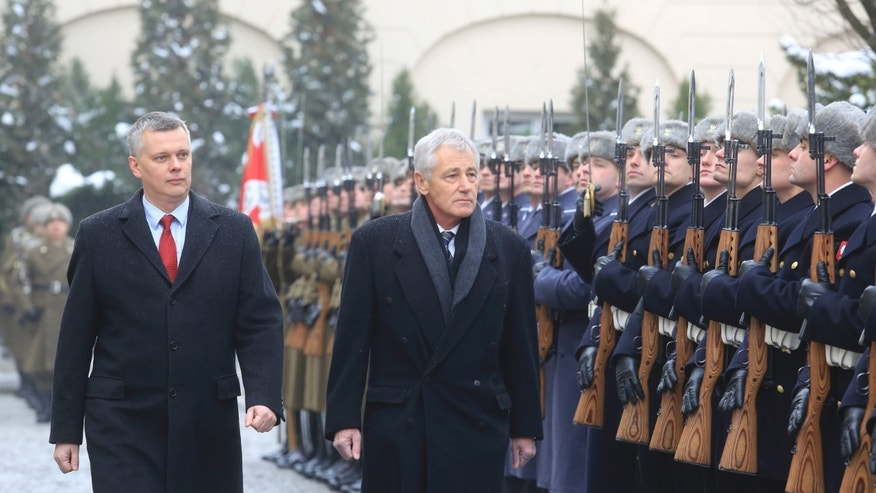 Jan. 30, 2014: Poland's Defense Minister Tomasz Siemoniak (L) walks with U.S. Defense Secretary Chuck Hagel in Warsaw.