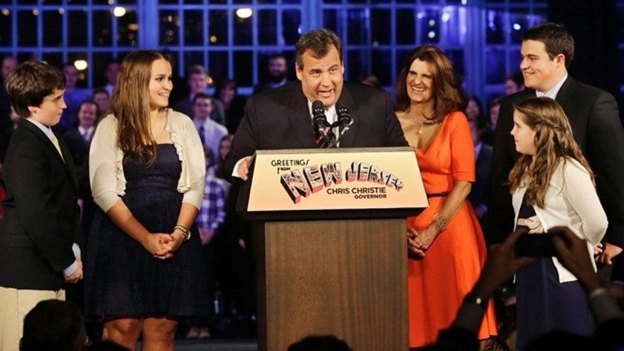 Nov. 5, 2013: New Jersey Gov. Chris Christie greets a gathering as he stands with his wife Mary Pat Christie, center right, and their children, Andrew, back right, Bridget, front right, Patrick, left, and Sarah, second left, in Asbury Park, N.J.