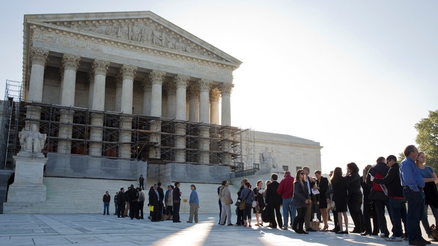 Oct. 15, 2013: People line up to hear oral arguments, including the case Schuette v. Coalition to Defend Affirmative Action, at the Supreme Court in Washington.