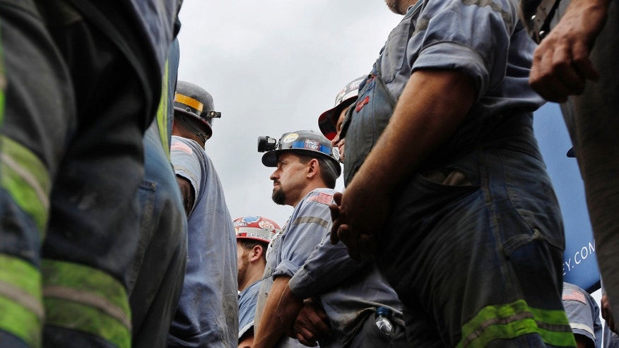FILE: August 14, 2012: Coal miners listen to Mitt Romney speak during the Beallsville Coal event at the American Energy Corporation in Beallsville, Ohio.