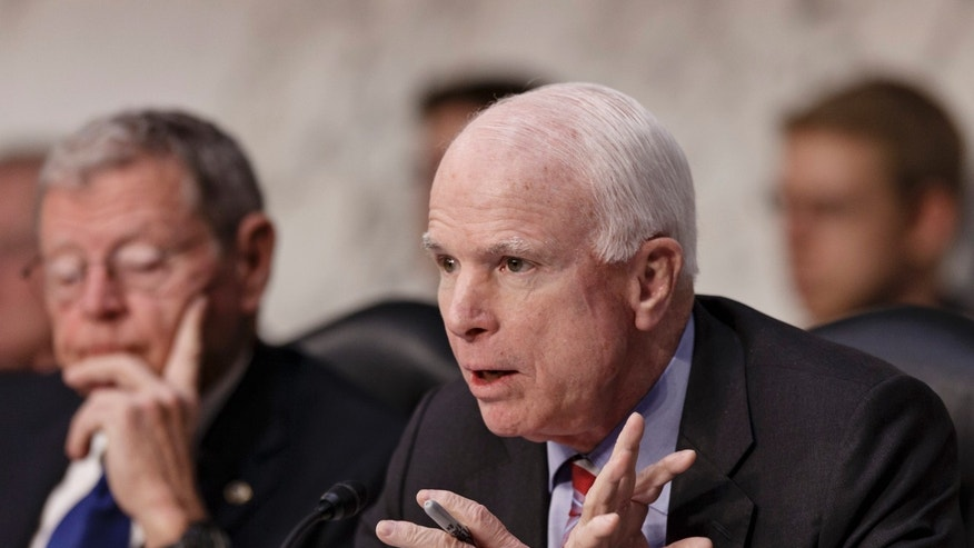 Mar. 5, 2014: Sen. John McCain, R-Ariz., questions Defense Secretary Chuck Hagel on Capitol Hill in Washington.