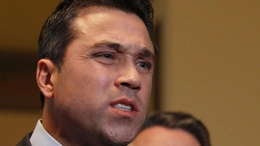 Jan 2, 2013: Representative Michael Grimm (R-NY) talks to the media. (Reuters)