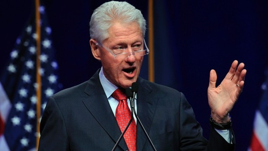 April 26, 2014: Former President Bill Clinton delivers the keynote at the annual Jefferson-Jackson Dinner at Cobo Hall in Detroit, Mich. (AP Photo/Jose Juarez)