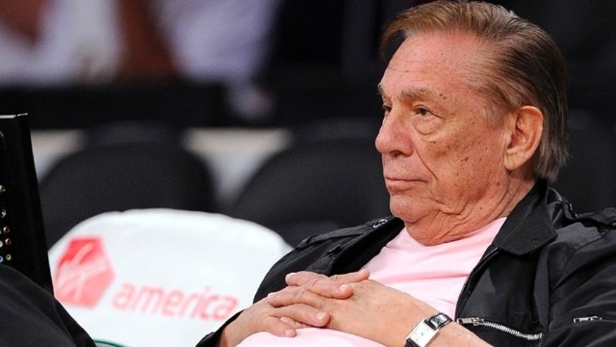 FILE - In this Oct. 17, 2010 file photo, Los Angeles Clippers team owner Donald Sterling watches his team play in Los Angeles. (AP Photo/Mark J. Terrill, File)