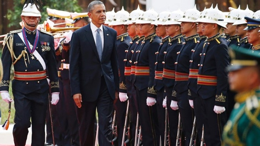 April 28, 2014: U.S. President Barack Obama reviews the honor guard at Malacanang Palace ahead of his bilateral meeting with Philippines President Benigno Aquino III in Manila. Obama is on the last stop of his four-country Asia trip. (AP Photo/Charles Dharapak)