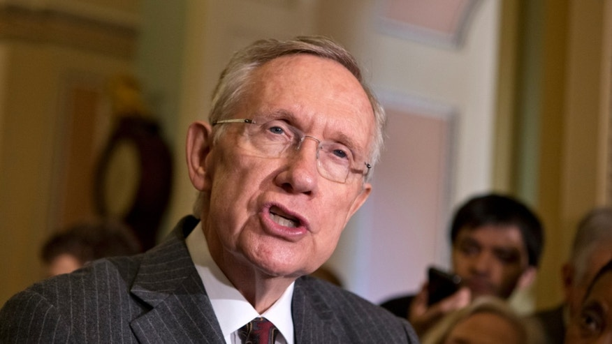 April 9, 2013: Senate Majority Leader Harry Reid, D-Nev., speaks with reporters about gun control at the Capitol in Washington.