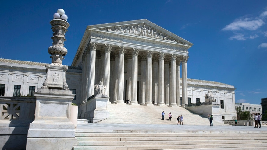 April 26, 2014: People walk on the steps of the U.S. Supreme Court in Washington.
