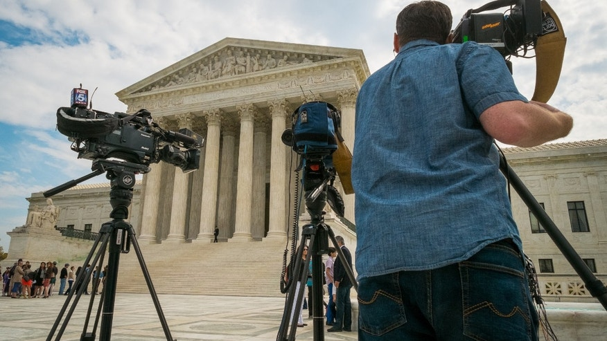 April 22, 2104: Videojournalists setting up outside the Supreme Court in Washington.