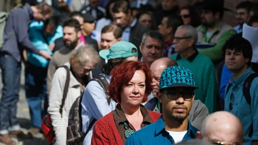 Job seekers line up to attend a job fair in Downtown Denver.