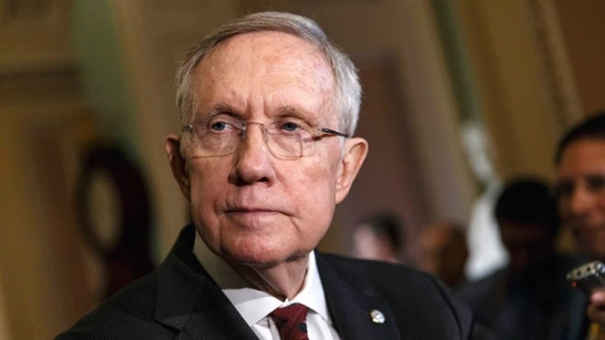 April 29, 2014: Senate Majority Leader Harry Reid talks to reporters on Capitol Hill in Washington.