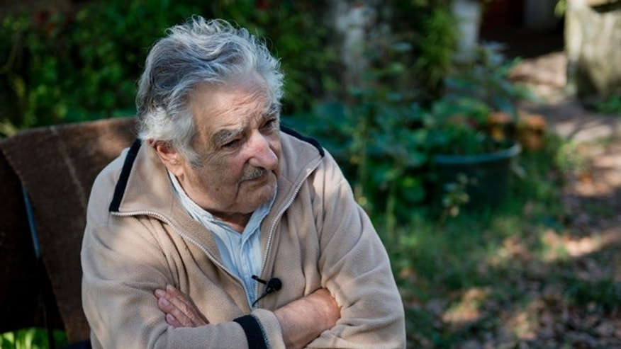 Uruguay's President Jose Mujica gives an interview at his home on the outskirts of Montevideo, Uruguay, Friday, May 2, 2014. Mujica says the country's legal marijuana market will be much less permissive with drug users. We dont go along with the idea that marijuana is benign, poetic and surrounded by virtues. No addiction is good, he said. In an exclusive Associated Press interview just before releasing his countrys long-awaited marijuana rules, the former leftist guerrilla predicted that many will call him an old reactionary once they see the fine print. (AP Photo/Matilde Campodonico)