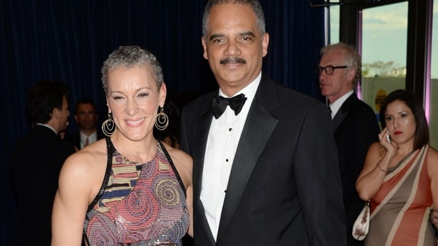 May 3, 2014: US Attorney General Eric Holder, right, and Sharon Malone arrive at the White House Correspondents' Association Dinner at the Washington Hilton Hotel in Washington. (AP)