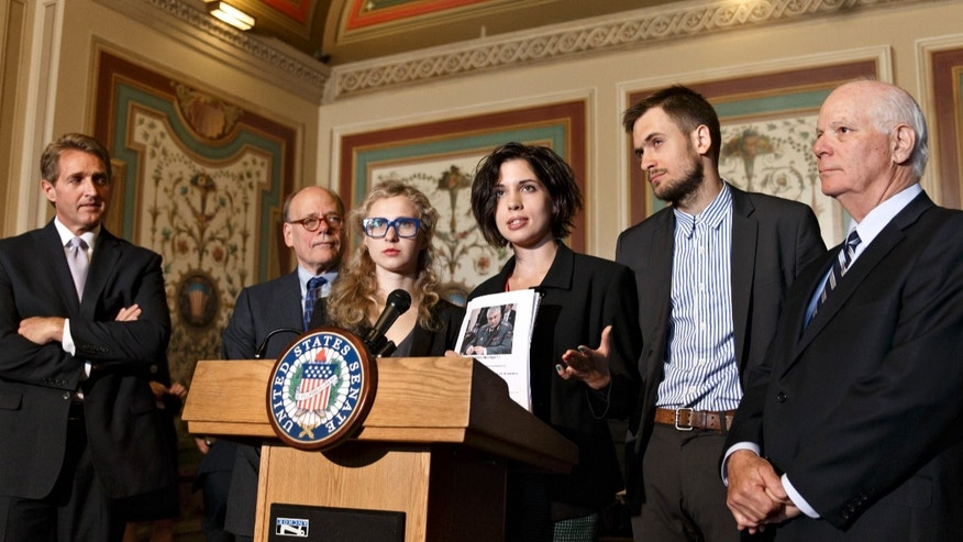 May 6, 2014: Russian political activists Nadya Tolokonnikova, center, and Maria Alyokhina, center left, of the Russian punk band Pussy Riot, join Sen. Ben Cardin, D-Md., far right, the chairman of the Helsinki Commission, Sen. Jeff Flake, R-Ariz., far left, and Rep. Steve Cohen, D-Tenn., second from left, in seeking action to stop violations of human rights by pro-Russian militants in the Ukraine region.