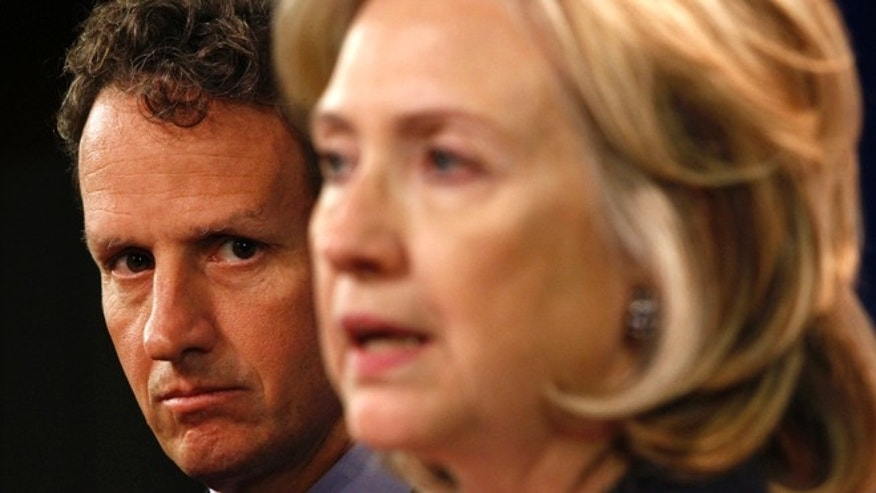 Sept. 29, 2010: Treasury Secretary Timothy Geithner, left, and Secretary of State Hillary Clinton speak about Iran from the State Department in Washington.
