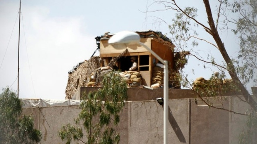 May 8, 2014: U.S. Marines on the roof of the Sheraton Sana'a Hotel where U.S. diplomats and embassy staffers stay in Sana'a.