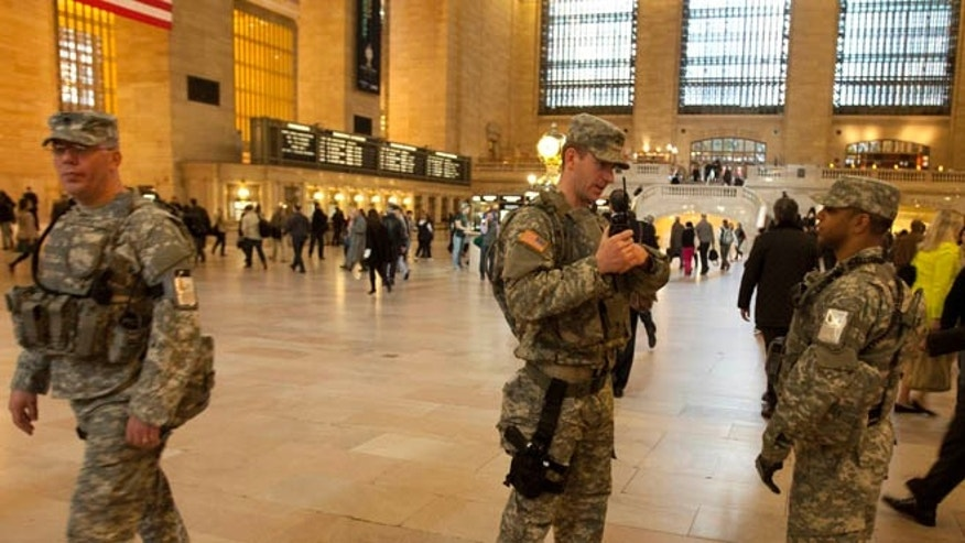 FILE: Army National Guard members patrol Grand Central Terminal, in New York, N.Y.