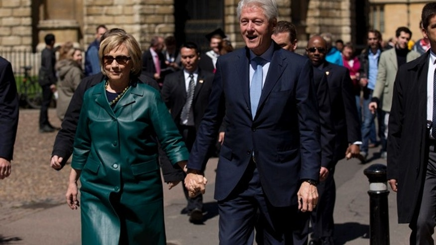 May 10, 2014: Former U.S. President Bill Clinton, center right, and his wife former Secretary of State Hillary Rodham Clinton walk away after they attended their daughter Chelsea's Oxford University graduation ceremony held at the Sheldonian Theatre in Oxford, England.