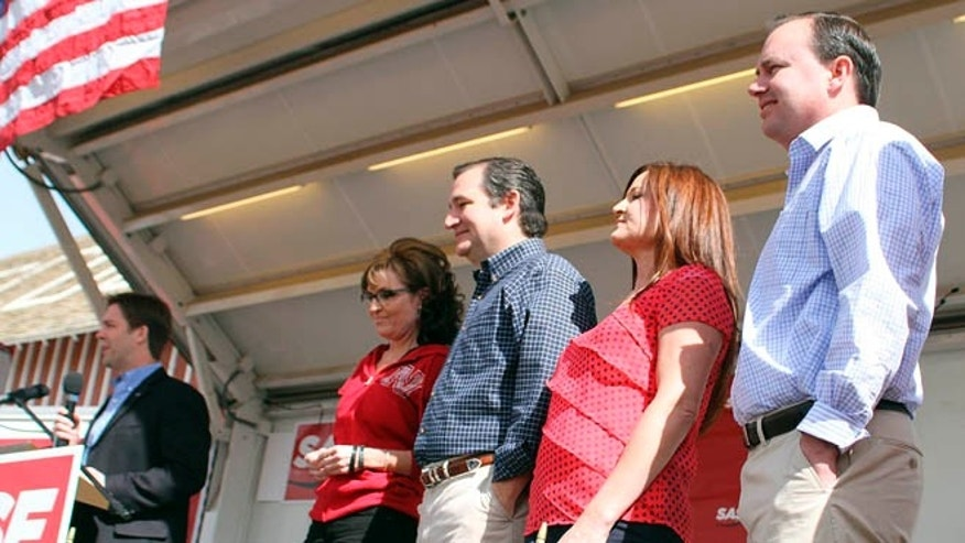 April 25, 2014: Republican Senate candidate Ben Sasse, left; former Alaska Gov. Sarah Palin; Texas Sen. Ted Cruz; Sharon Lee; Utah Sen. Mike Lee, stand together on the platform in North Platte, Neb., at a rally for Sasse.