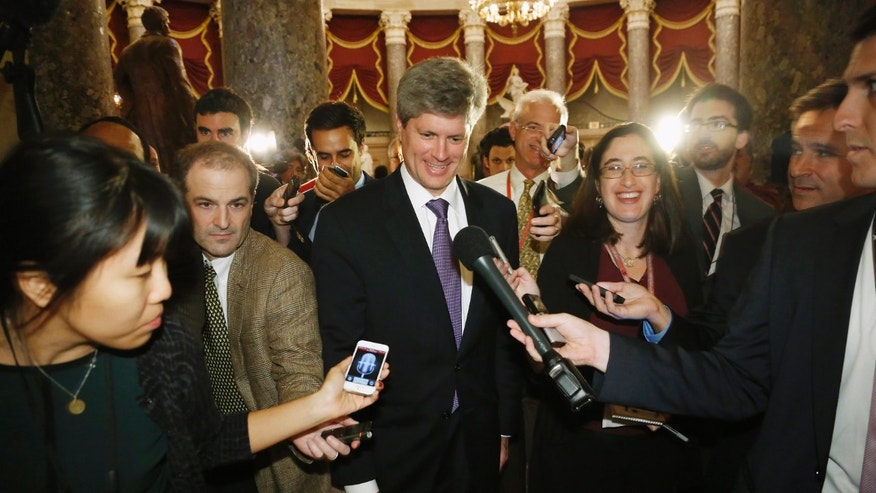 U.S. Representative Jeff Fortenberry is trailed by reporters as he walks from the offices of House Speaker John Boehner at the U.S. Capitol in Washington.