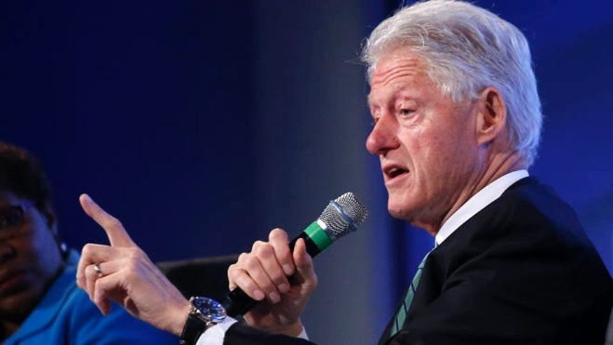 May 14, 2014: Former President Bill Clinton answers questions at the 2014 Fiscal Summit organized by the Peter G. Peterson Foundation in Washington.