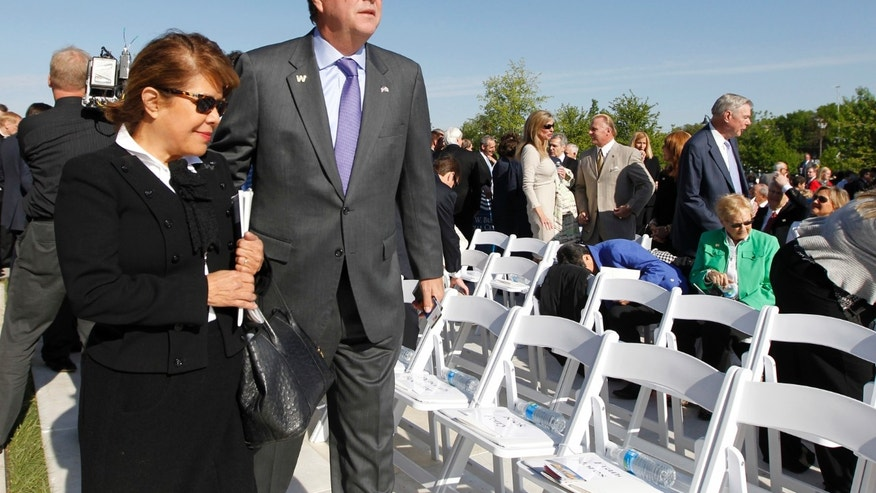 April 25, 2013: Former Florida Governor Jeb Bush and his wife Columba arrive at the dedication ceremony for the George W. Bush Presidential Center in Dallas.