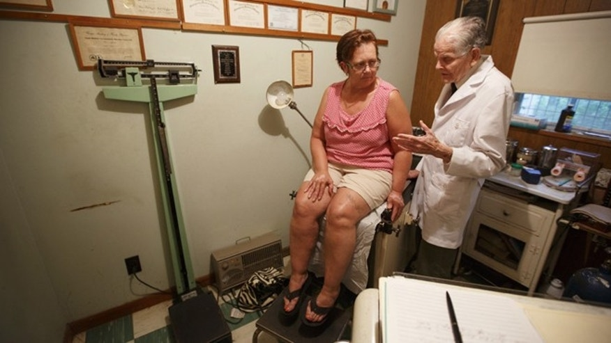 July 14, 2013: A doctor in Altamont, Tenn., examines a patient at a rural clinic.
