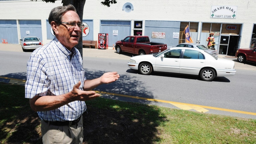 May 7, 2014: Steve Rodgers stands outside his thrift store as he discusses his support for a plan to widen U.S. 431 through historic Eufaula, Ala.