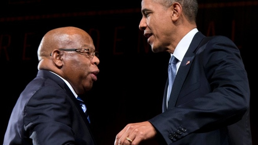 April 10, 2014: This photo shows President Barack Obama greeted by Rep. John Lewis, D-Ga., as he arrives to speak at the LBJ Presidential Library in Austin, Texas.